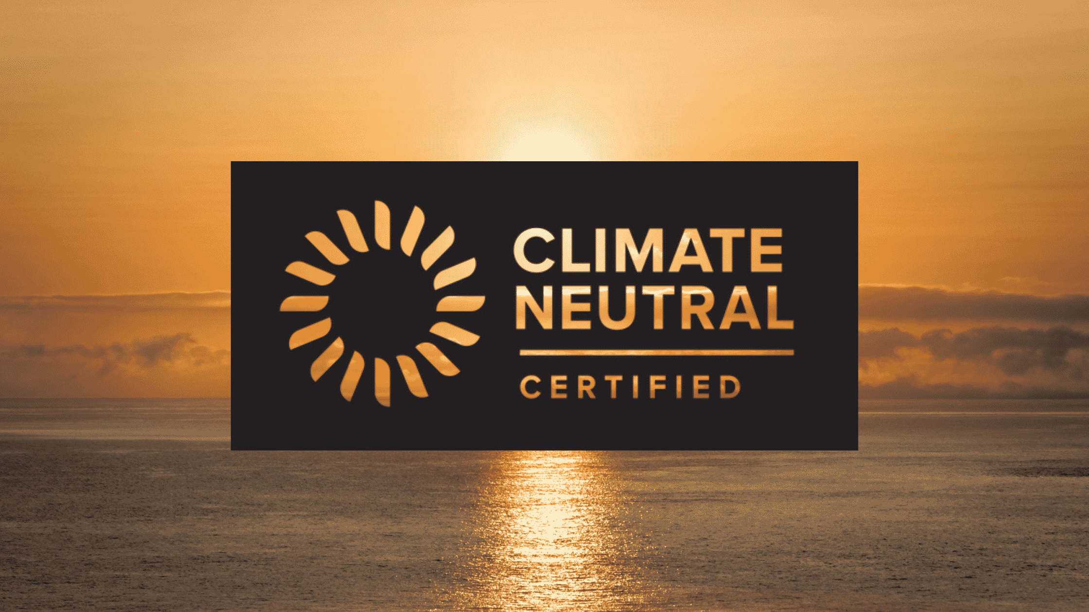 sunrise over the ocean with the climate neutral certification logo